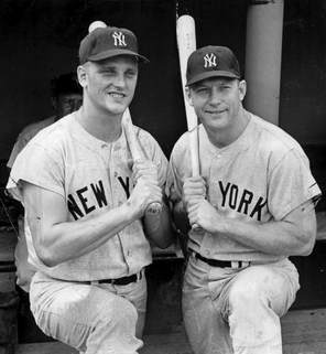 Picture Roger Maris and Mickey Mantle hold bats.